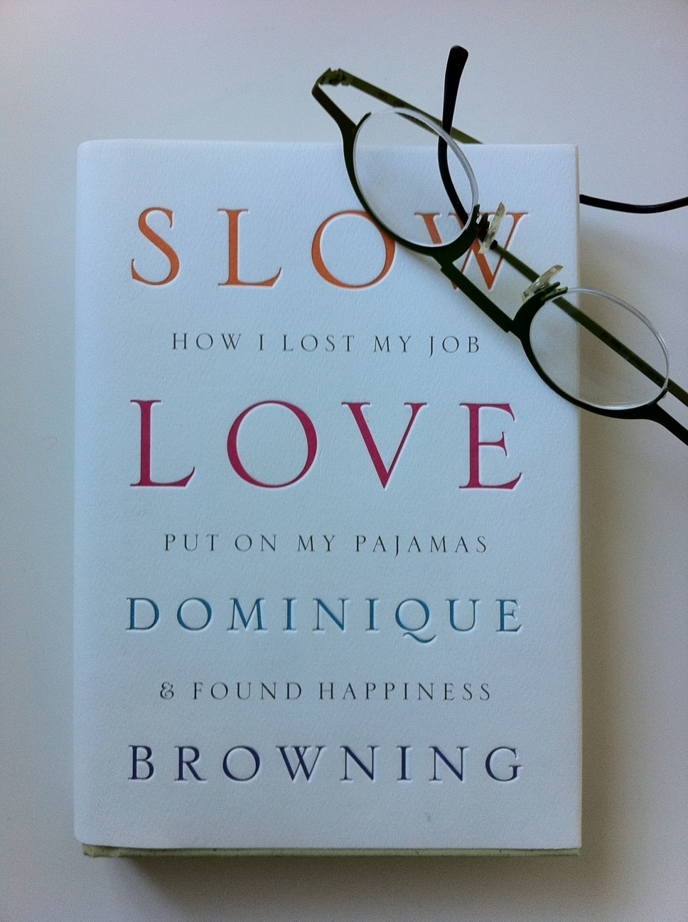 slow love life book with glasses